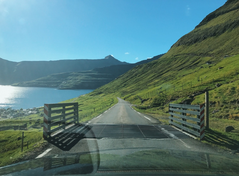 Driving on the one car road heading to Gjogv, Faroe Islands.