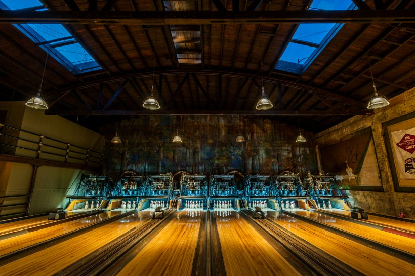 A beautiful old bowling alley from the 1920's with polished wooden floors.