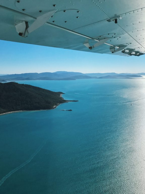 Whitsunday day trips, Whitsundays trip, whitsunday island tours, sailing whitsundays, camping whitsundays, ultimate guide to whitsunday, Queensland day trips, scenic flight