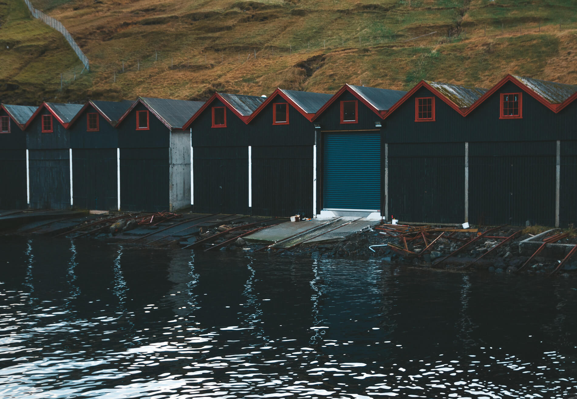 Colourful boatsheds Vestamanna, faroe islands facts, visit faroe islands