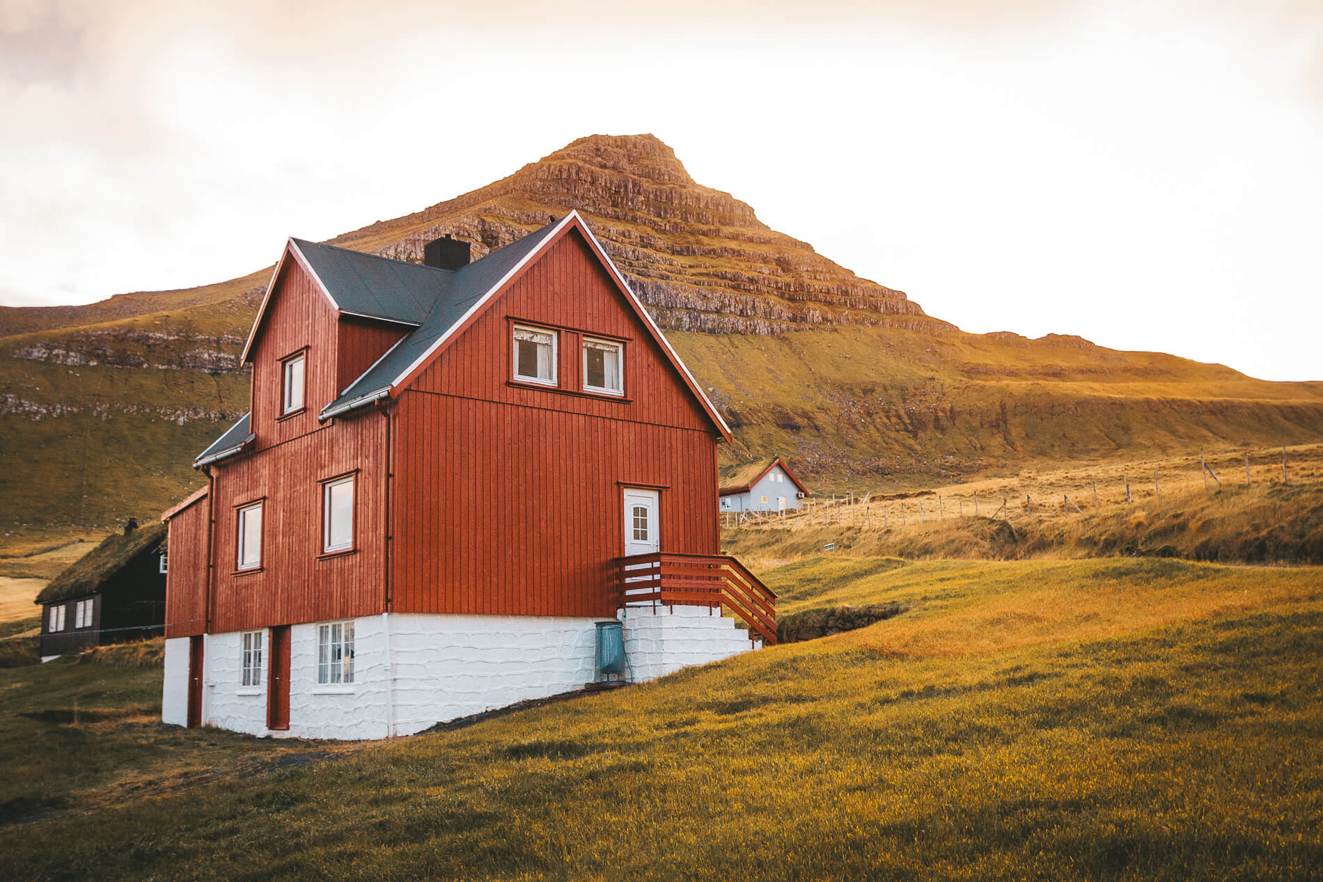 Mikladalur red house and sunset, faroe islands facts, visit faroe islands